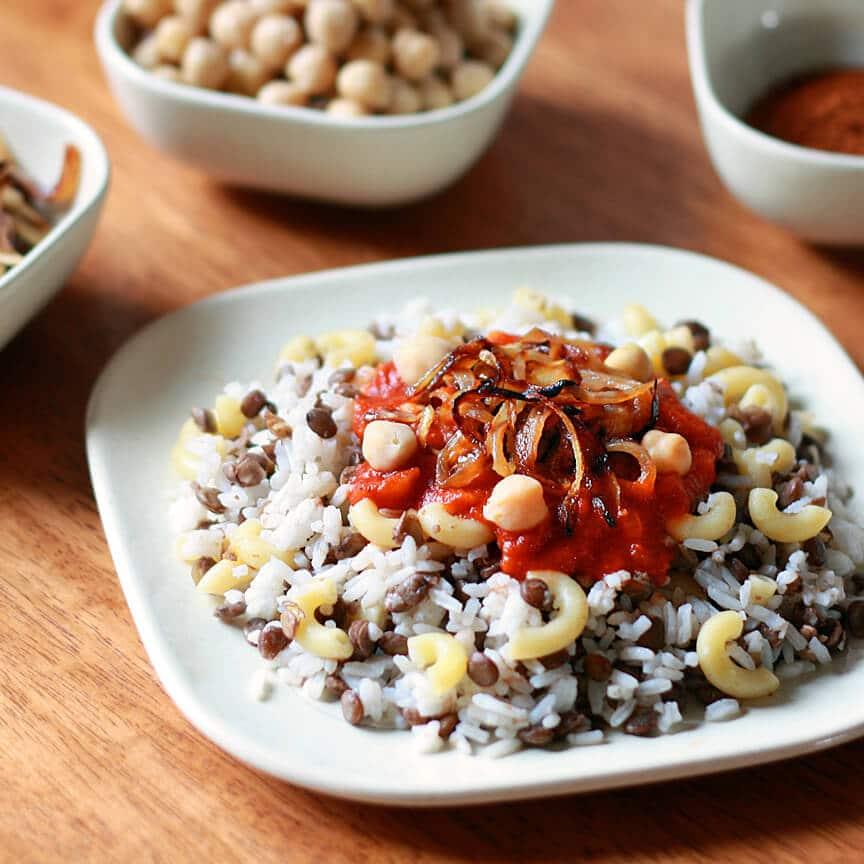 Koshari Koshary national dish Egypt rice lentils macaroni baharat spicy tomato sauce