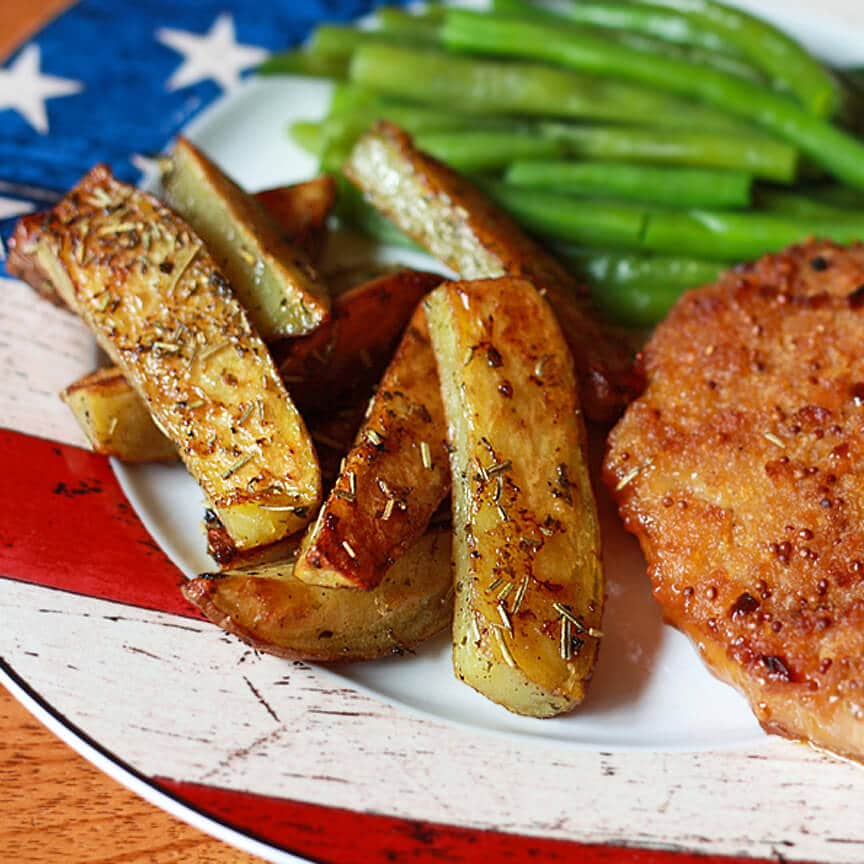 ... about these yummy Herb-Roasted Potato Wedges to serve with the chops