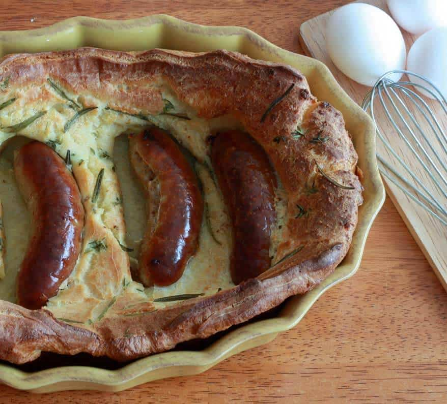 traditional authentic British english toad in the hole recipe sausages bangers baked yorkshire pudding