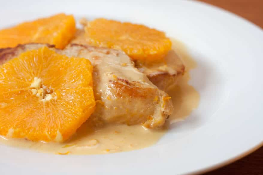 chicken and sliced oranges on a serving platter and pour the sauce ...