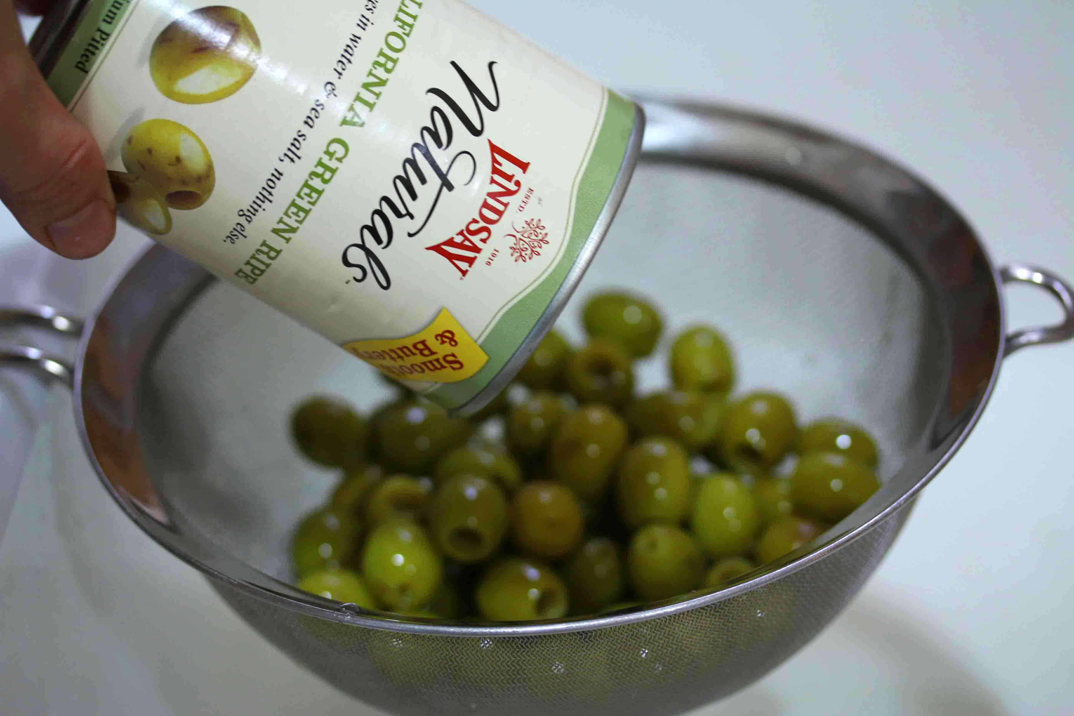 pouring olives from can