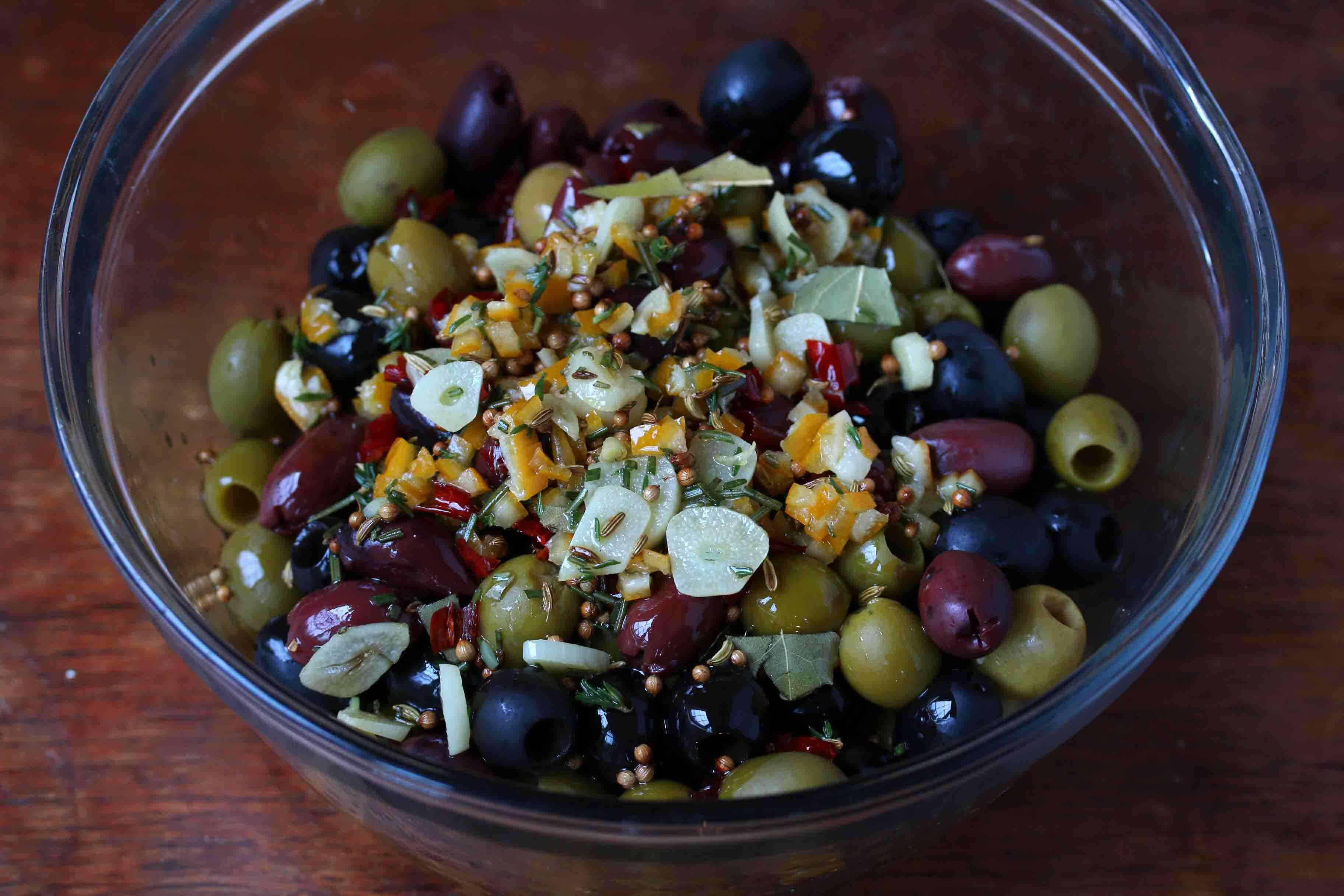 stir marinade and olives together