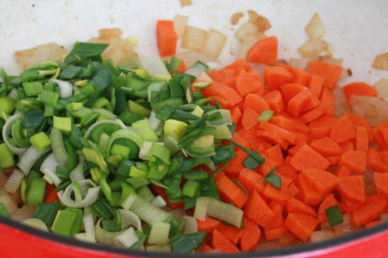 add the butter carrots and leek and cook for another 5 minutes