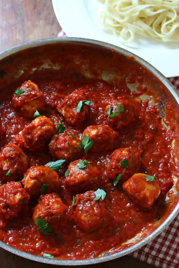 Shape into large meatballs, about 1 1/2 inches in diameter. Put the meatballs in a container; cover and refrigerate for at least 1 hour. In a large skillet or saute pan over medium heat, heat the oil.