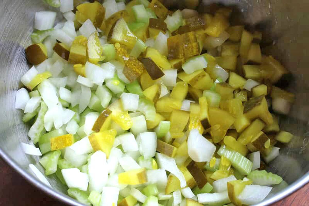 combining the pickles onions and celery