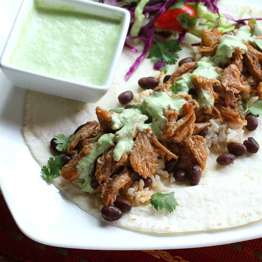 Pulled Pork Burritos with Creamy Tomatillo Sauce - The Daring Gourmet