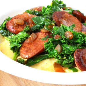 andouille sausage greens cheese grits collards kale Cajun seasoning