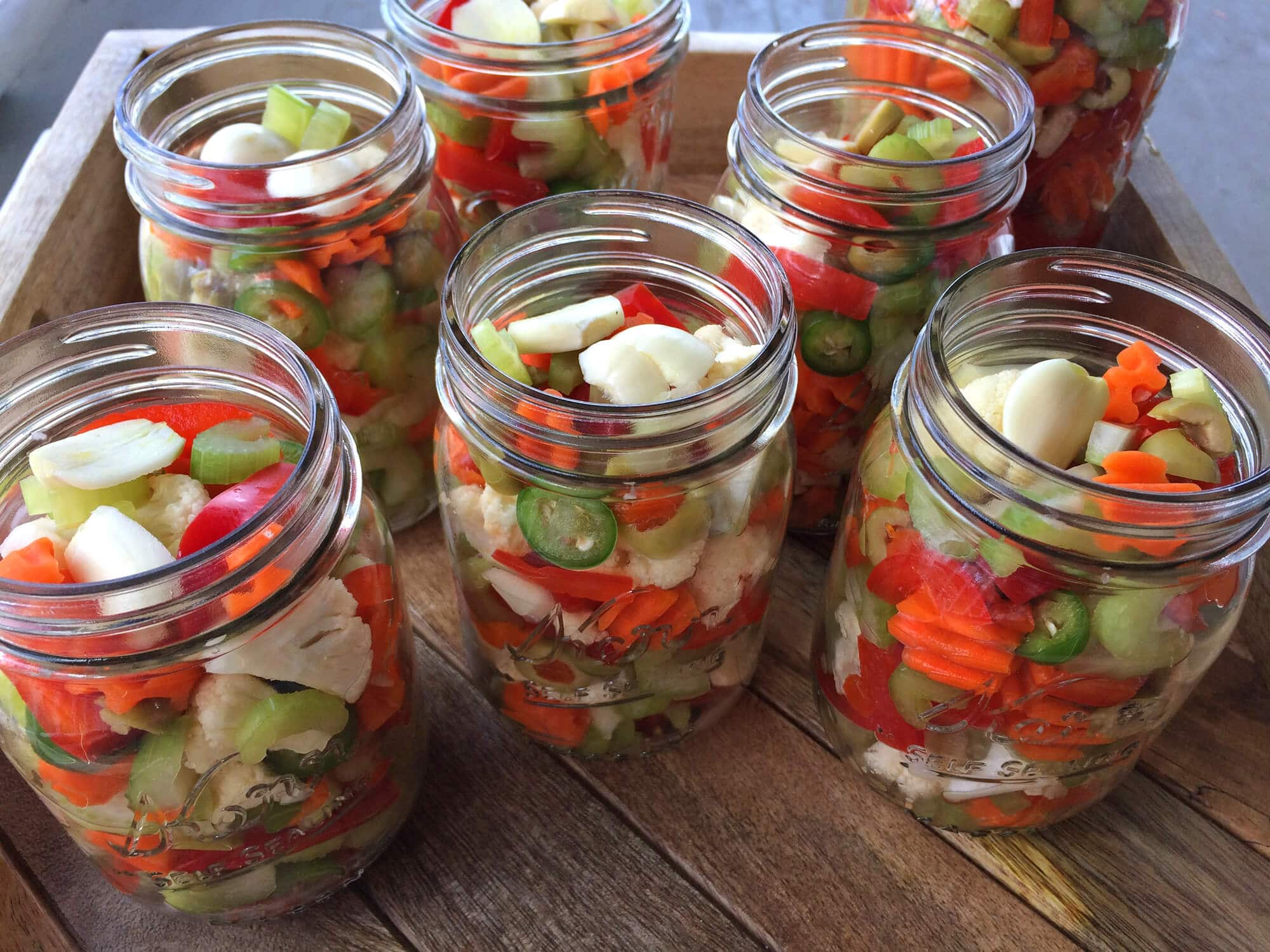best italian chicago style giardiniera recipe pickled vegetables olives cauliflower celery carrots peppers hot mild muffuletta