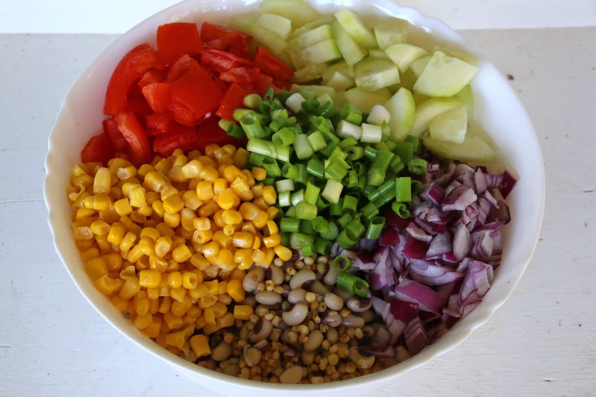 sorghum grain salad black eyed peas southern recipe healthy vegetables vinaigrette dressing smoked paprika cucumbers tomatoes corn