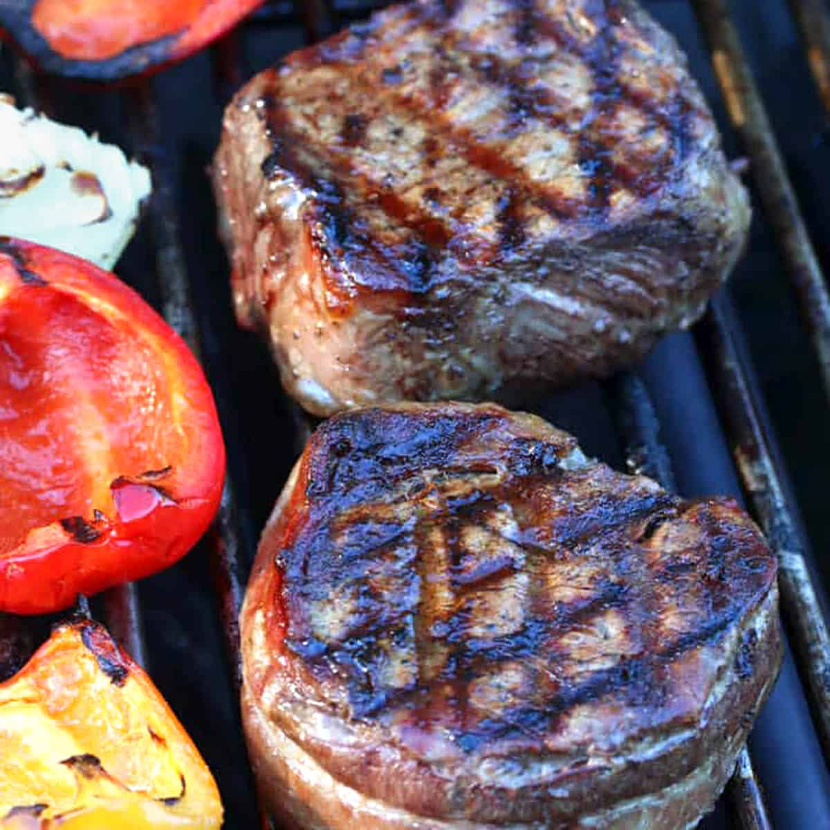 grilled steaks on grill